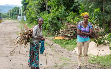 A pair of Ari women each carry a load of firewood in a village near Jinka in the Omo Valley.